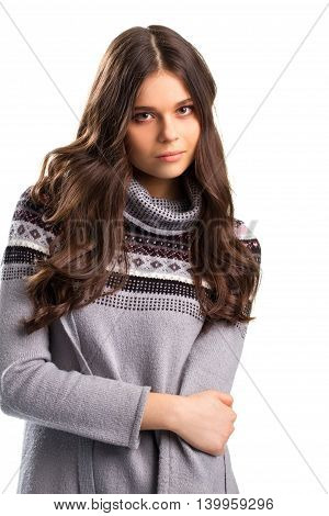 Confident face of young woman. Sweater with black print. We need to talk seriously. Calm and patience.