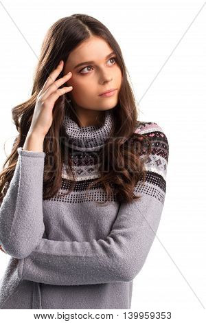 Thoughtful woman on blank background. Gray patterned sweatshirt. Which solution is best. So many interesting thoughts.