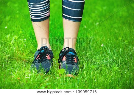 Close Up Of Running Shoes On Grass.