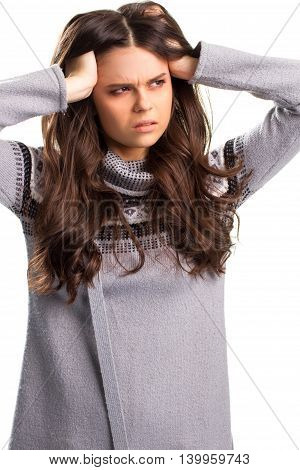 Woman holds head with hands. Caucasian lady in gray pullover. Exhausted and puzzled. Never been so tired.