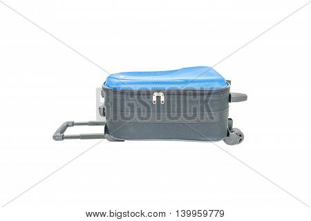 Closeup blue luggage isolated on white background fabric luggage with plastic roller for travel with clipping path