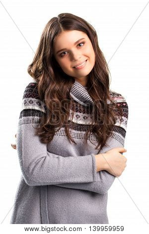 Woman with folded arms smiling. Gray sweatshirt with small pattern. Living a happy life. Share your smile with world.