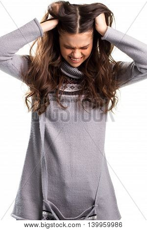 Woman is pulling hair. Sweatshirt with small pink pattern. Stressed lady on white background. Please stop it.