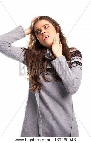 Lady touches face with hand. Sweater with pink pattern. Nervous and scared face. Don't think about the worst.