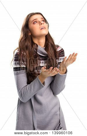 Desperate woman on white background. Girl in a sweater. Please help me. Need one more chance.