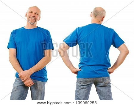 Photo of a man in his early fifties posing with a blank blue t-shirt ready for your artwork or design.