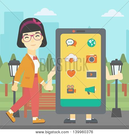 An asian young woman walking with a big smartphone. Woman and big smartphone in the park. Woman holding the hand of smartphone. Smartphone addiction. Vector flat design illustration. Square layout.