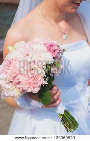 bride in white dress with bouquet a