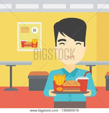 An asian young man holding tray full of junk food on a cafe background. Smiling man in fast food restaurant. Man having lunch in a fast food restaurant. Vector flat design illustration. Square layout.