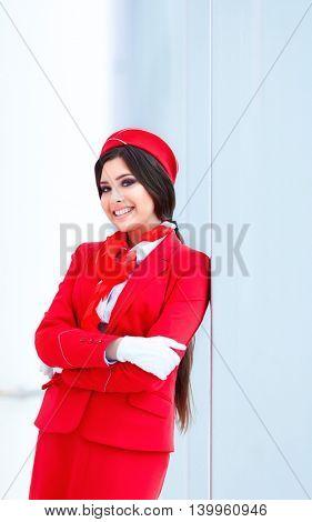 Smiling stewardess in uniform