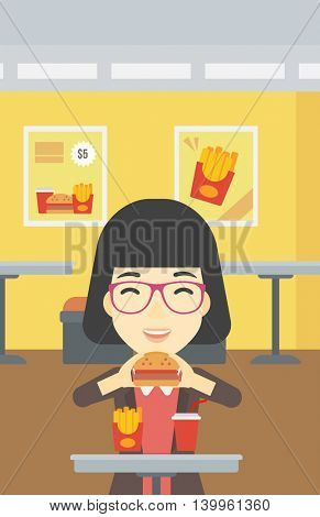 An asian young woman eating hamburger. Happy woman with eyes closed craving hamburger. Woman is about to eat delicious hamburger in the cafe. Vector flat design illustration. Vertical layout.