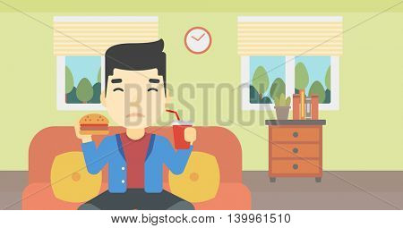 An asian young man sitting on a sofa while eating hamburger and drinking soda on the background of living room. Vector flat design illustration. Horizontal layout.