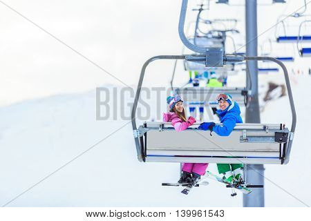 Sports people on a lift