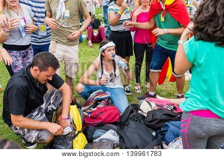 Poznan POLAND - JULY 24 2016: pilgrims resting during Days In Dioceses just before The World Youth Day in Krakow; WYD is an international meeting of youth from all over the world
