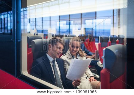 Smiling people in a train