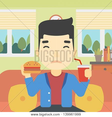 An asian young man sitting on a sofa while eating hamburger and drinking soda on the background of living room. Vector flat design illustration. Square layout.
