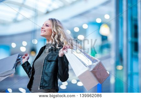 Happy woman in a store