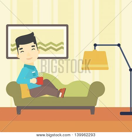 An asian young man lying on sofa in living room and holding a cup of hot flavored tea. Vector flat design illustration. Square layout.