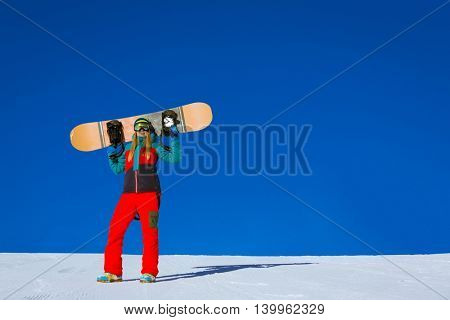 Active woman with snowboards outdoors