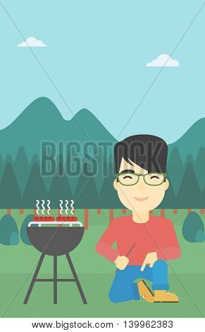 An asian man sitting next to barbecue grill in the park. Man cooking meat on the barbecue grill. Man having a barbecue party. Vector flat design illustration. Vertical layout.