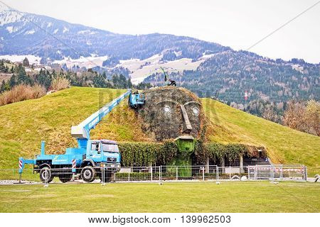 WATTENS AUSTRIA - April 7 2012: Entrance to the Swarovski Crystal Worlds (Kristallwelten) museum. The green giant face was under construction.
