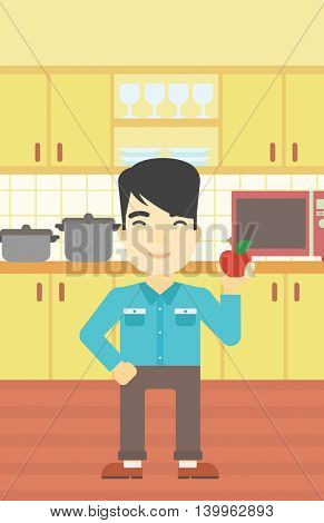 An asian man holding an apple in the kitchen. Young man eating an apple in the kitchen. Man with an apple at home. Vector flat design illustration. Vertical layout.