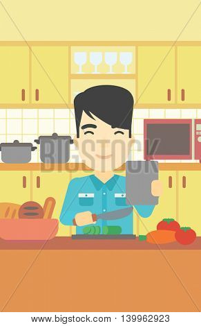 An asian man cutting vegetables for salad. Man following recipe for salad on digital tablet. Man cooking vegetable salad in the kitchen. Vector flat design illustration. Vertical layout.