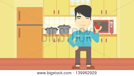 An asian man holding an apple in the kitchen. Young man eating an apple in the kitchen. Man with an apple at home. Vector flat design illustration. Horizontal layout.
