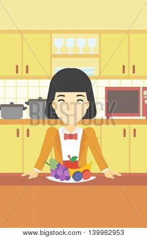 An asian woman standing in front of table full of fresh fruits in the kitchen. Woman with plate full of fruits. Healthy food concept. Vector flat design illustration. Vertical layout.