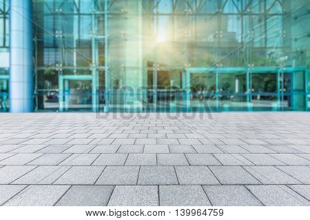 Empty brick floor with modern building wall,china.