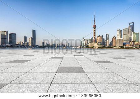 Empty brick floor with shanghai skyline and cityscape,china.