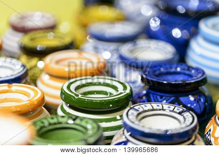 colored ceramic ashtrays for sale in a bazaar