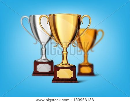 Gold silver bronze cups  isolated on a blue background
