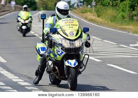 ESSEX UK 7 JUNE 2015: Police Escort Motorcyclist