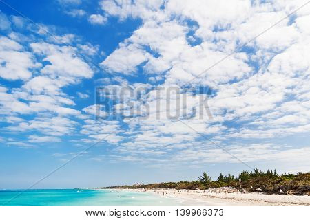 Tourists relax on Varadero sandy beach. Cuba.