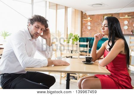 Couple upset with each other in restaurant