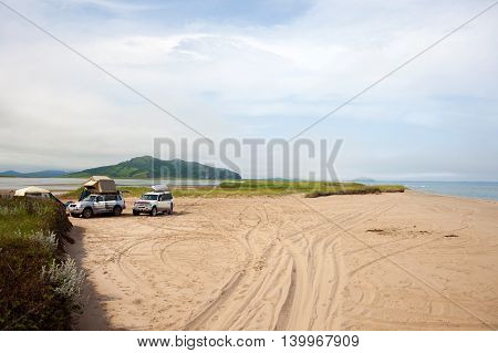 KHASAN RUSSIA - JULY 23 2015: Automobile camp on sandy beach
