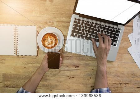 usiness man working with laptop and smart phone. top view
