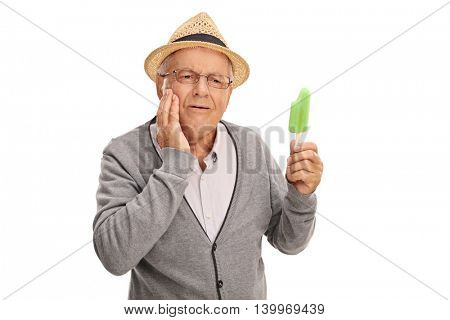 Mature man experiencing a tooth ache from eating ice cream isolated on white background