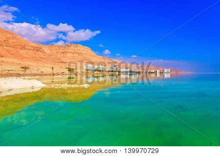 The shoaled Dead Sea at coast of Israel. Emerald water of the Dead Sea