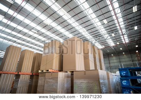 Low angle view of cardboard boxes put on pallets in a warehouse