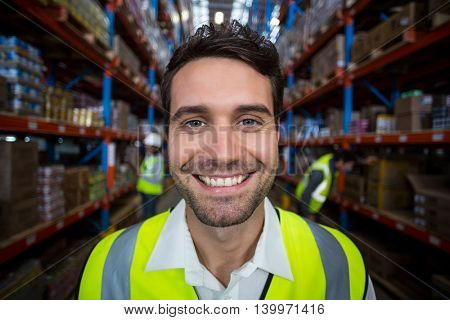 Close-up of smiling worker in warehouse