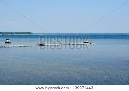 pier on the big lake under the blue sky in the summer
