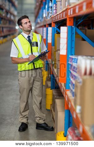 Worker controlling stocks in warehouse