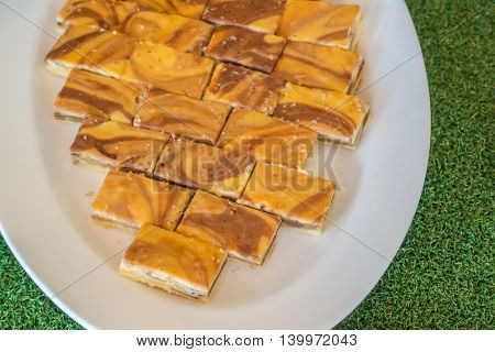 Small cakes on white dish  in buffet