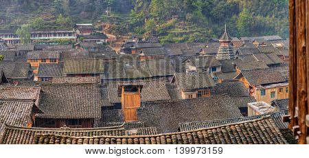 Tile roofs farmhouses in the mountain village of ethnic minorities in southwest China, Zhaoxing Dong Village Guizhou Province.
