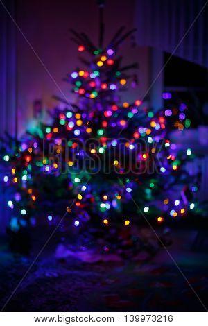 blur light celebration on christmas tree with black background