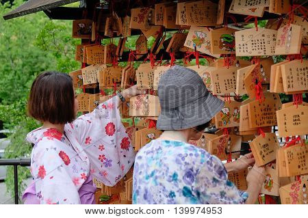 KYOTO JAPAN JUL 9 2016: Tourists walk on a street around Kiyomizu. Kiyomizu is a famous temple in Kyoto built in year 778. That is part of the Historic Monuments of Ancient Kyoto