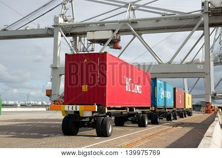 ROTTERDAM NETHERLANDS - SEP 6 2015: Row of containers ready to be transported onto a ship in a container terminal in the Port of Rotterdam