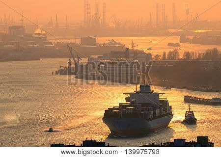 ROTTERDAM NETHERLANDS - MAR 16 2016: Maersk container ship on the Meuse river in the Port of Rotterdam during sunset